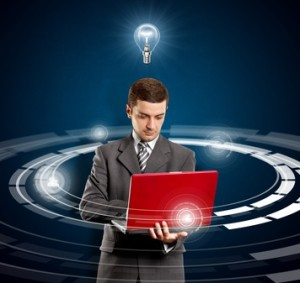 Idea concept, Business man with red laptop in his hands and lamp above